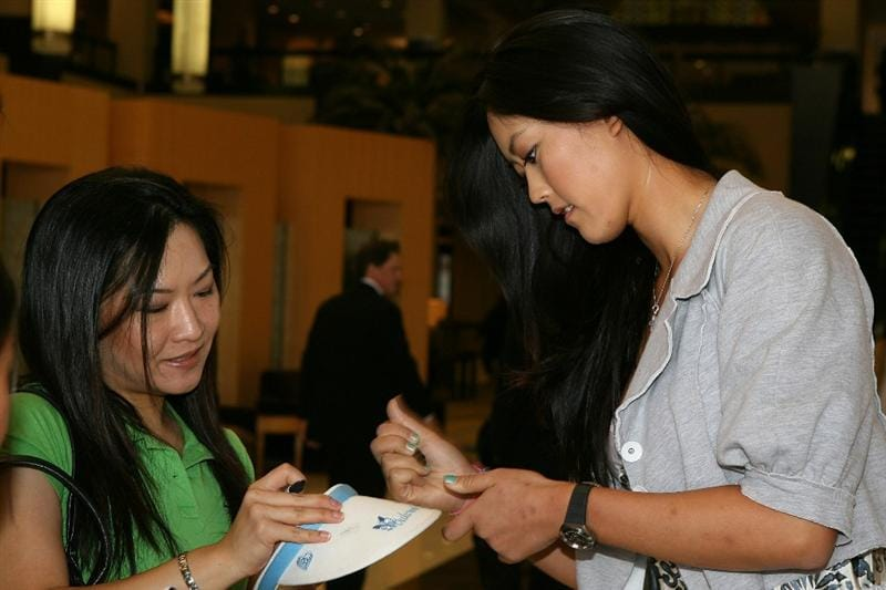 LOS ANGELES, CA - SEPTEMBER 18:  Michelle Wie signs an autograph for a fan before a press conference to announce the Kia Classic LPGA event to be held in March of 2011 on September 18, 2010 at Industry Hills Golf Club at Pacific Palms in City of Industry, California.  (Photo by Jeff Golden/Getty Images)