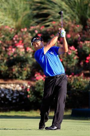 PONTE VEDRA BEACH, FL - MAY 15:  K.J. Choi of South Korea hits his tee shot on the 18th hole during the final round of THE PLAYERS Championship held at THE PLAYERS Stadium course at TPC Sawgrass on May 15, 2011 in Ponte Vedra Beach, Florida.  (Photo by Sam Greenwood/Getty Images)