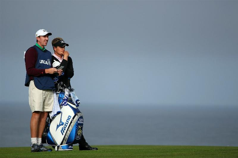 PEBBLE BEACH, CA - JUNE 17:  Luke Donald of England (R) looks on from the 11th hole with his caddie John McLaren during the first round of the 110th U.S. Open at Pebble Beach Golf Links on June 17, 2010 in Pebble Beach, California.  (Photo by Andrew Redington/Getty Images)