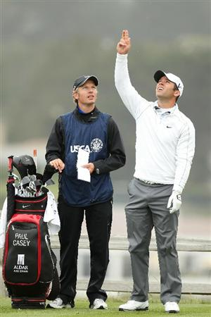 PEBBLE BEACH, CA - JUNE 18:  Paul Casey of England waits with his caddie Christian Donald on the seventh tee during the second round of the 110th U.S. Open at Pebble Beach Golf Links on June 18, 2010 in Pebble Beach, California.  (Photo by Ross Kinnaird/Getty Images)