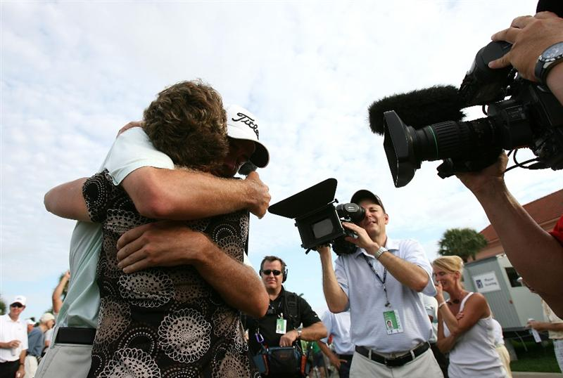 WEST PALM BEACH, FL - DECEMBER 07:  Troy Merritt hugs his mom Zoe Merritt after winning medalist honors during the final round of the 2009 PGA TOUR Qualifying Tournament at Bear Lakes Country Club on December 7, 2009 in West Palm Beach, Florida.  (Photo by Doug Benc/Getty Images)