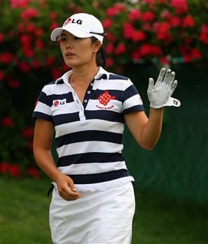 EVIAN, FRANCE - JULY 26:  Angela Park of USA waves to the crowd on the 18th hole during the third round of the Evian Masters at the Evian Masters Golf Club on July 26, 2008 in Evian, France.  (Photo by Andrew Redington/Getty Images)