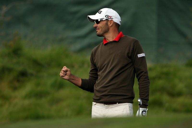 PEBBLE BEACH, CA - JUNE 19:  Gregory Havret of France celebrates making a birdie on the 14th hole during the third round of the 110th U.S. Open at Pebble Beach Golf Links on June 19, 2010 in Pebble Beach, California.  (Photo by Andrew Redington/Getty Images)