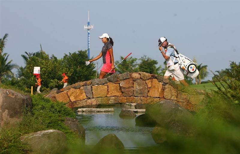 HAIKOU, CHINA - OCTOBER 24: (CHINA OUT) Seon Hwa Lee (L) of South Korea on the 18th hole during day one of the Grand China Air LPGA 2008 on October 24, 2008 in Haikou of Hainan Province, China. (Photo by China Photos/Getty Images)