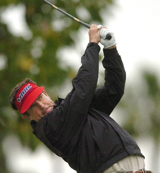 Bruce Lietzke watches the flight of his shot from the 12th tee during the first round of the Champions' Tour 2005  Toshiba Senior Classic at the Newport Beach Country Club in Newport Beach, California March 18, 2005.