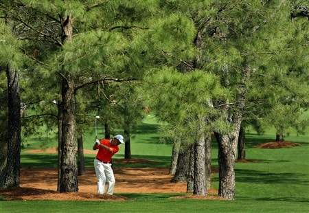 AUGUSTA, GA - APRIL 11:  Toru Taniguchi of Japan hits a shot from the trees during the second round of the 2008 Masters Tournament at Augusta National Golf Club on April 11, 2008 in Augusta, Georgia.  (Photo by Harry How/Getty Images)