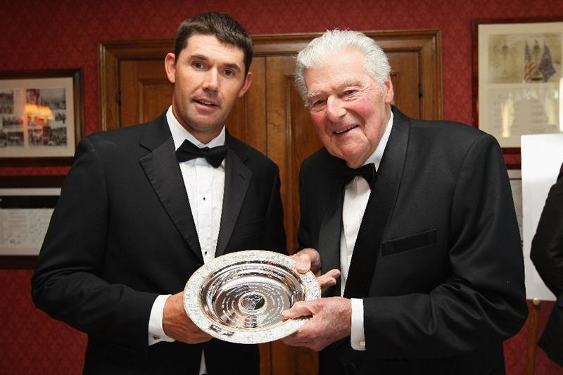 WENTWORTH, ENGLAND - MAY 19:  Padraig Harrington of Ireland (L) is presented with the European Golfer of the Year by John Jacobs (R) of England during The Tour Dinner at  the BMW PGA Championship at Wentworth on May 19, 2009 in Virginia Water, England.  (Photo by Andrew Redington/Getty Images)