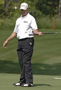 John Elway misses a putt on the 15th green at the Cliffs at Keowee Vineyards during the first round of the Nationwide Tour BMW Charity Pro-Am, April 27, 2006 in Greenville, South Carolina.Photo by Al Messerschmidt/WireImage.com