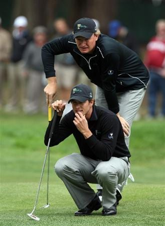 SAN FRANCISCO - OCTOBER 08: Ernie Els of South Africa and the International Team helps his partner Adam Scott of Australia line up a putt at the 3rd hole during the Day One Foursome Matches in The Presidents Cup at Harding Park Golf Course on October 8, 2009 in San Francisco, California  (Photo by David Cannon/Getty Images)
