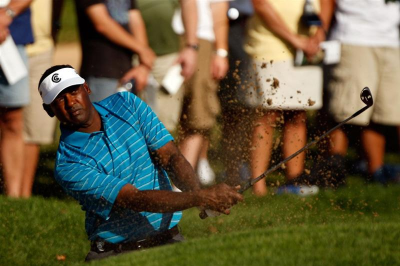 CHASKA, MN - AUGUST 14:  Vijay Singh of Fiji plays a bunker shot on the 13th hole during the second round of the 91st PGA Championship at Hazeltine National Golf Club on August 14, 2009 in Chaska, Minnesota.  (Photo by Streeter Lecka/Getty Images)
