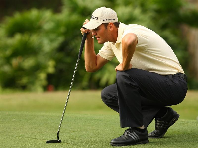 SHENZHEN, CHINA - NOVEMBER 28:  Martin Kaymer of Germany lines a put during the Fourballs on the 3rd day of the Omega Mission Hills World Cup on the Olazabal course on November 28, 2009 in Shenzhen, China.  (Photo by Ian Walton/Getty Images)