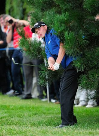 VIENNA, AUSTRIA - SEPTEMBER 19: Danny Willett of England plays his approach shot on the 16th hole during the final round of the Austrian golf open presented by Botarin at the Diamond country club on September 19, 2010 in Atzenbrugg near Vienna, Austria.  (Photo by Stuart Franklin/Getty Images)
