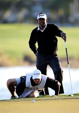 PALM BEACH GARDENS, FL - MARCH 05:  Vijay Singh of Fiji looks over a birdie putt on the 18th hole during the second round of the Honda Classic at PGA National Resort And Spa on March 5, 2010 in Palm Beach Gardens, Florida.  (Photo by Sam Greenwood/Getty Images)