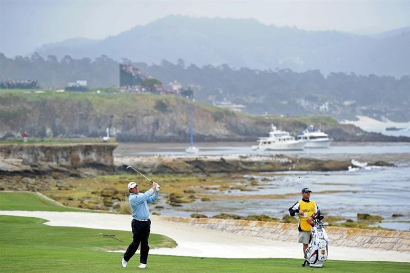 PEBBLE BEACH, CA - JUNE 18:  Lee Westwood of England plays a shot on the 18th hole as his caddie Billy Foster looks on during the second round of the 110th U.S. Open at Pebble Beach Golf Links on June 18, 2010 in Pebble Beach, California.  (Photo by Harry How/Getty Images)
