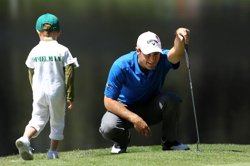 AUGUSTA, GA - APRIL 06:  Trevor Immelman of South Africa waits with his son Jacob on a green during the Par 3 Contest prior to the 2011 Masters Tournament at Augusta National Golf Club on April 6, 2011 in Augusta, Georgia.  (Photo by Andrew Redington/Getty Images)