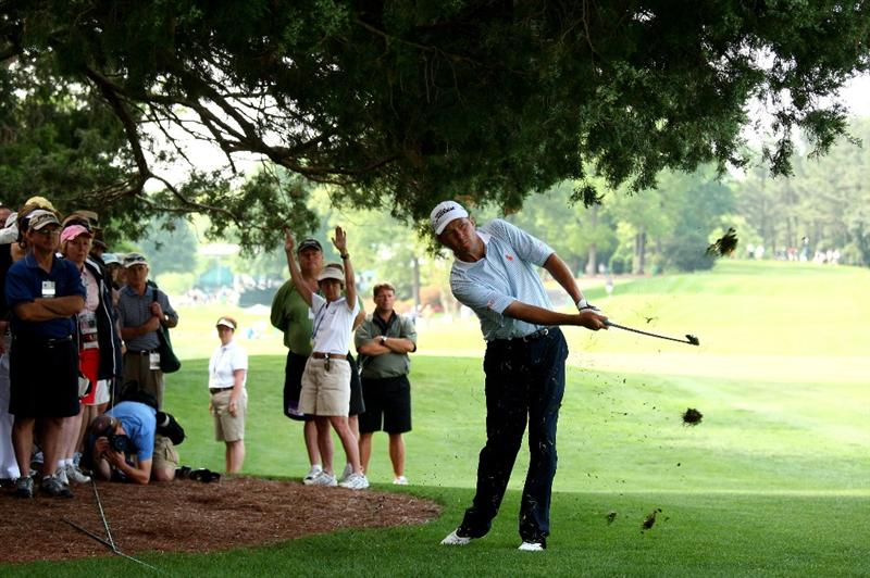 CHARLOTTE, NC - MAY 01:  Davis Love III of the USA plays into the 18th green from under a tree during the second round of the Quail Hollow Championship at Quail Hollow Club on May 1, 2009 in Charlotte, North Carolina.  (Photo by Richard Heathcote/Getty Images)