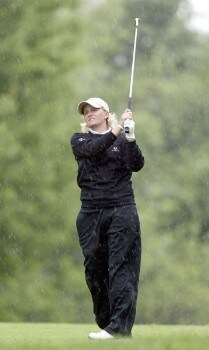 Becky Morgan plays through a downpour on her way to a 64 and the lead during the first round of the 2005 Wegman's Rochester LPGA at Locust Hill Country Club in  Pittsford, New York on June 16, 2005.Photo by Michael Cohen/WireImage.com