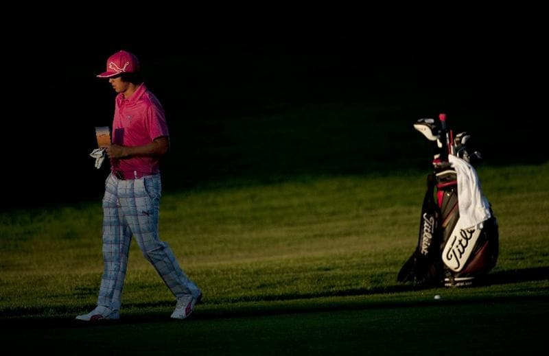 SAN MARTIN, CA - OCTOBER 14:  Rickie Fowler walks away from his golf bag on the 10th fairway during the first round of the Frys.com Open at the CordeValle Golf Club on October 14, 2010 in San Martin, California.  (Photo by Robert Laberge/Getty Images)