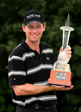 JOHANNESBURG, SOUTH AFRICA - JANUARY 11:  Anders Hansen of Denmark holds the trophy after his final round 66 to secure a one shot victory in the final round of the Joburg Open at Royal Johannesburg and Kensington Golf Club on January 11, 2009 in Johannesburg, South Africa.  (Photo by Richard Heathcote/Getty Images)
