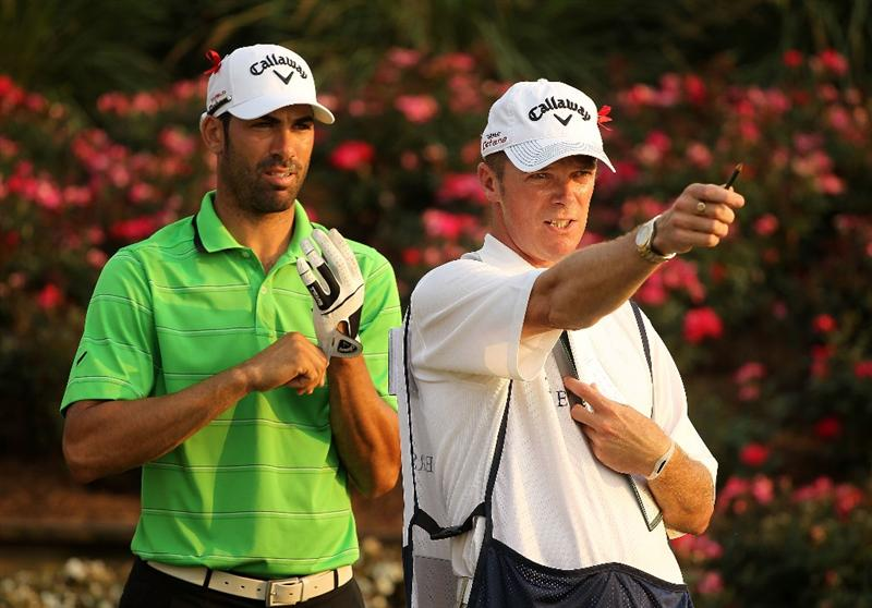 PONTE VEDRA BEACH, FL - MAY 12:  Alvaro Quiros of Spain chats with his caddie Gareth Lord on the 18th hole during the first round of THE PLAYERS Championship held at THE PLAYERS Stadium course at TPC Sawgrass on May 12, 2011 in Ponte Vedra Beach, Florida.  (Photo by Scott Halleran/Getty Images)