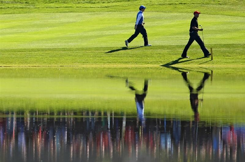 NEWPORT, WALES - OCTOBER 04:  Rory McIlroy of Europe walks with Stewart Cink (R) of the USA on the 13th hole in the singles matches during the 2010 Ryder Cup at the Celtic Manor Resort on October 4, 2010 in Newport, Wales.  (Photo by Jamie Squire/Getty Images)