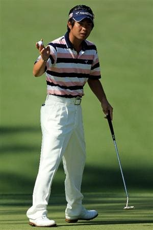 AUGUSTA, GA - APRIL 07:  Yuta Ikeda of Japan waves to the crowd on the tenth green during the first round of the 2011 Masters Tournament at Augusta National Golf Club on April 7, 2011 in Augusta, Georgia.  (Photo by David Cannon/Getty Images)