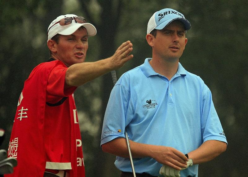 SHANGHAI, CHINA - NOVEMBER 06:  Peter Lawrie of Ireland chats with his caddie on the ninth hole during the first round of the HSBC Champions at Sheshan International Golf Club on November 6, 2008 in Shanghai, China.  (Photo by Scott Halleran/Getty Images)
