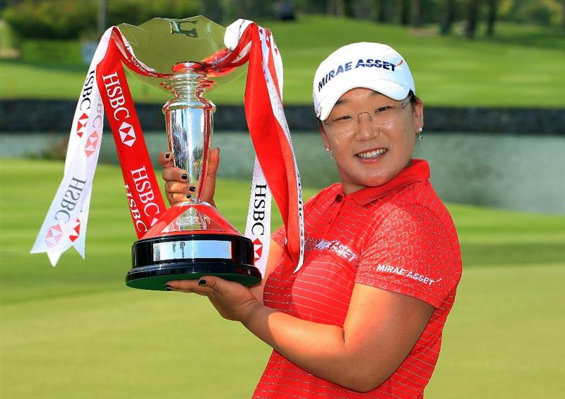 SINGAPORE - MARCH 08:  Jiyai Shin of South Korea poses with the trophy after her two-stroke victory at the HSBC Women's Champions at the Tanah Merah Country Club on March 8, 2009 in Singapore  (Photo by Scott Halleran/Getty Images)