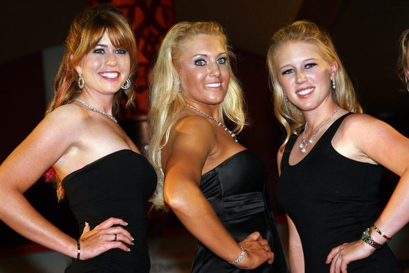 SINGAPORE - MARCH 04:  Paula Creamer, Natalie Gulbis and Morgan Pressel of the USA on the catwalk at the 'Welcolm Reception' prior to the HSBC Women's Champions at the Tanah Merah Country Club on March 4, 2009 in Singapore.  (Photo by Ross Kinnaird/Getty Images)