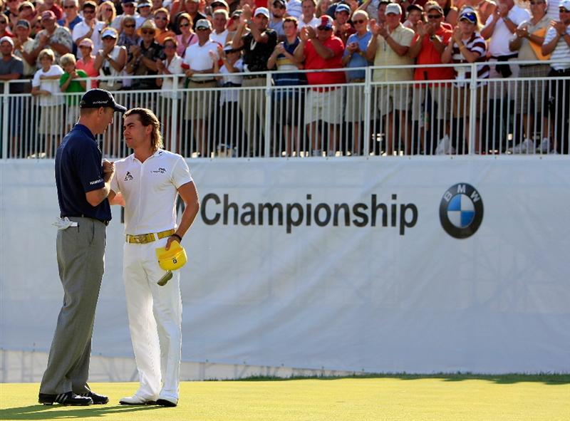 ST. LOUIS - SEPTEMBER 07:  Camilo Villegas of Colombia is congratulated by Jim Furyk after winning the BMW Championship on September 7, 2008 at Bellerive Country Club in St. Louis, Missouri.  (Photo by Jamie Squire/Getty Images)