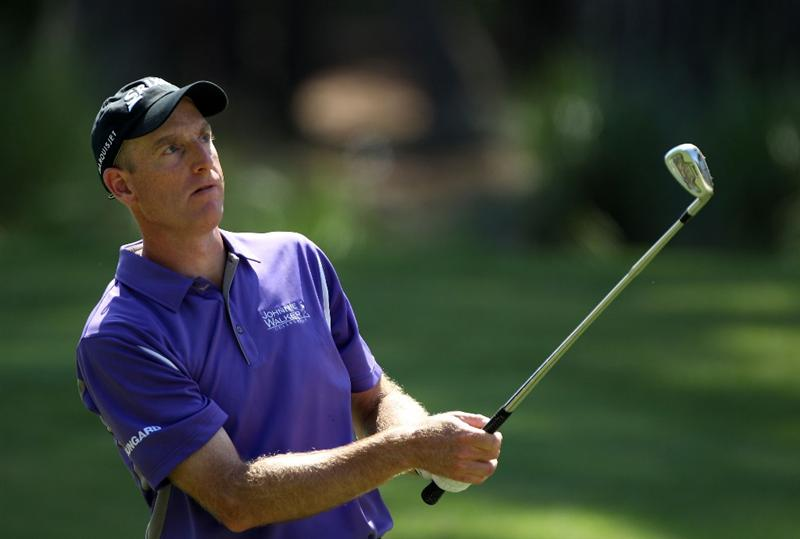 PONTE VEDRA BEACH, FL - MAY 07:  Jim Furyk watches his approach shot on the tenth hole during the second round of THE PLAYERS Championship held at THE PLAYERS Stadium course at TPC Sawgrass on May 7, 2010 in Ponte Vedra Beach, Florida.  (Photo by Scott Halleran/Getty Images)