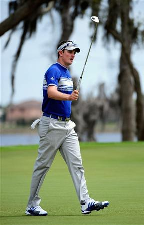 ORLANDO, FL - MARCH 22:  Justin Rose of England celebrates on the 9th green during the first day's play in the 2010 Tavistock Cup at Isleworth Golf and Country Club on March 22, 2010 in Orlando, Florida.  (Photo by Sam Greenwood/Getty Images)