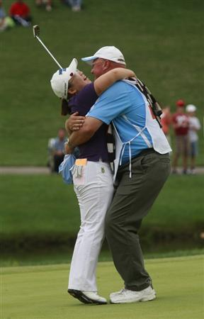 ROGERS, AR - SEPTEMBER 13:  LPGA golfer Jiyai Shin hugs her caddie Dean Herden after winning the P&G Beauty NW Arkansas Championship at the Pinnacle Country Club on September 13, 2009 in Rogers, Arkansas. Shin won after a two-hole playoff.  (Photo by Dave Martin/Getty Images)