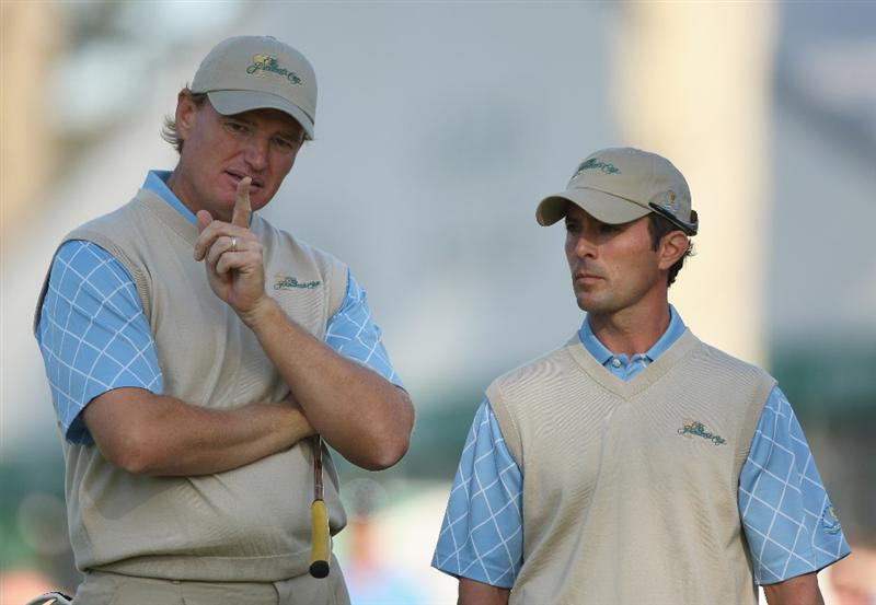 SAN FRANCISCO - OCTOBER 09:  Ernie Els and Mike Weir of the International Team have a chat during the Day Two Fourball Matches of The Presidents Cup at Harding Park Golf Course on October 9, 2009 in San Francisco, California.  (Photo by Warren Little/Getty Images)
