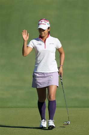 RANCHO MIRAGE, CA - APRIL 01:  Ai Miyazato of Japan waves after making her birdie putt on the second hole during the second round of the Kraft Nabisco Championship at Mission Hills Country Club on April 1, 2011 in Rancho Mirage, California.  (Photo by Stephen Dunn/Getty Images)