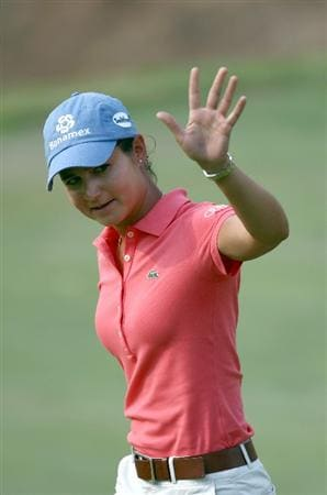 MORELIA, MEXICO- APRIL 25: Lorena Ochoa of Mexico waves to the crowd after her putt on the 18th hole during the thrid round of the Corona Championship at the Tres Marias Residential Golf Club on April 25, 2009 in Morelia, Michoacan, Mexico. (Photo by Donald Miralle/Getty Images)