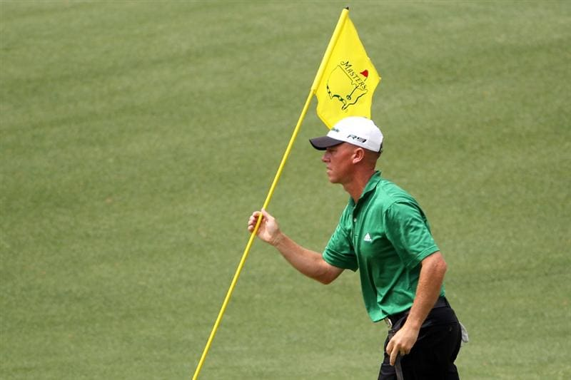 AUGUSTA, GA - APRIL 10:  Nathan Green of Australia holds the flag on the first hole during the third round of the 2010 Masters Tournament at Augusta National Golf Club on April 10, 2010 in Augusta, Georgia.  (Photo by Jamie Squire/Getty Images)