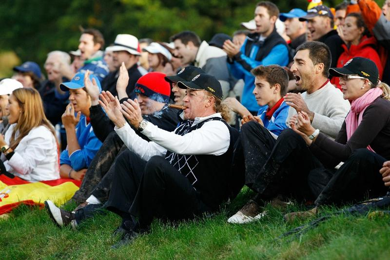 NEWPORT, WALES - OCTOBER 03:  Miguel Angel Jimenez of Europe cheers on his team mates during the  Fourball & Foursome Matches during the 2010 Ryder Cup at the Celtic Manor Resort on October 3, 2010 in Newport, Wales.  (Photo by Sam Greenwood/Getty Images)