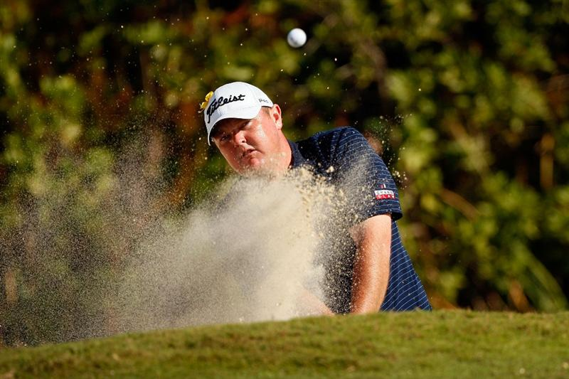 RIVIERA MAYA, MEXICO - FEBRUARY 27:  Jarrod Lyle makes a shot from a bunker on the fifth hole during the second round of the Mayakoba Golf Classic on February 27, 2009 at El Camaleon Golf Club in Riviera Maya, Mexico.  (Photo by Chris Graythen/Getty Images)