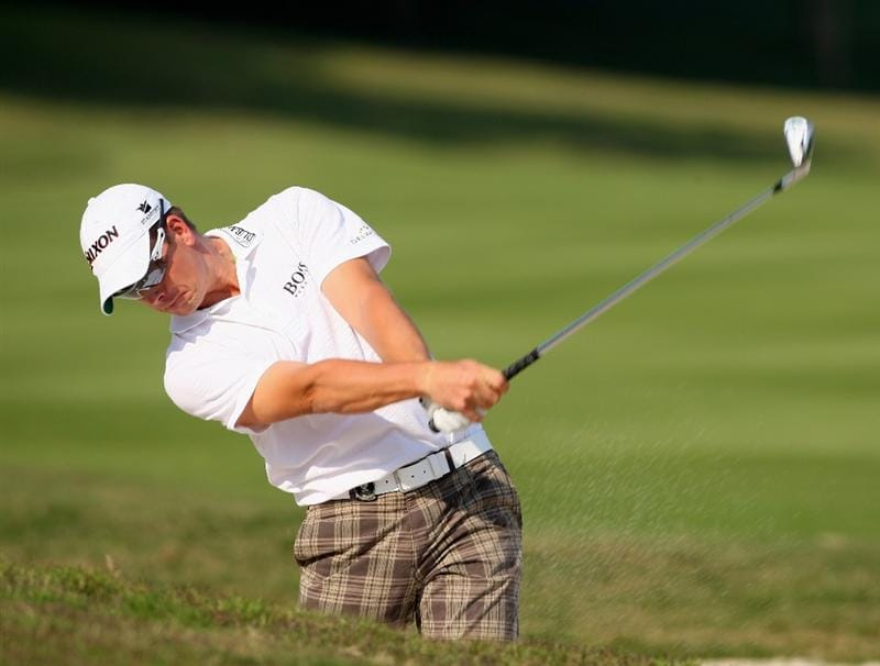 SHENZHEN, CHINA - NOVEMBER 26:  Henrik Stenson of Sweden plays his bunker shot during the pro - am of the Omega Mission Hills World Cup at the Mission Hills Resort on November 26, 2008 in Shenzhen, China.  (Photo by Stuart Franklin/Getty Images)