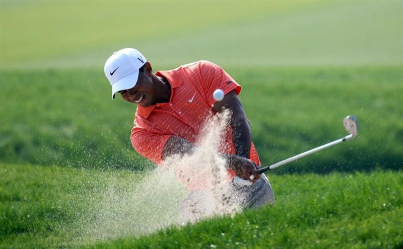 SHANGHAI, CHINA - NOVEMBER 05:  Tiger Woods of the USA plays out of a bunker on the 10th, his opening hole, during the first round of the WGC - HSBC Champions at Sheshan International Golf Club on November 5, 2009 in Shanghai, China.  (Photo by Ross Kinnaird/Getty Images)