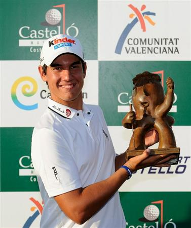 CASTELLON DE LA PLANA, SPAIN - OCTOBER 24:  Matteo Manassero of Italy holds the trophy after winning his first professional tournament at the age of 17 after the final round of the Castello Masters Costa Azahar at the Club de Campo del Mediterraneo on October 24, 2010 in Castellon de la Plana, Spain.  (Photo by Stuart Franklin/Getty Images)