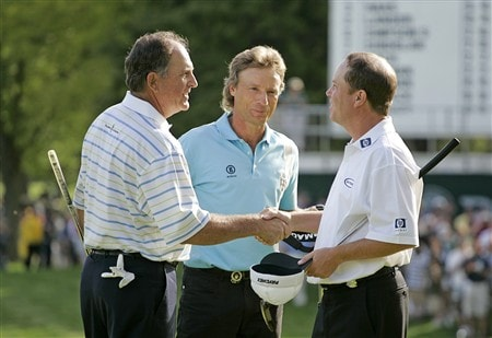 ROCHESTER, NY - MAY 25: Jay Haas (L) shakes hands with playing partners Jeff Sluman (R) and Bernhard Langer after the final round of the 69th Senior PGA Championship at Oak Hill Country Club - East Course on May 25, 2008 in Rochester, New York. (Photo by Hunter Martin/Getty Images)