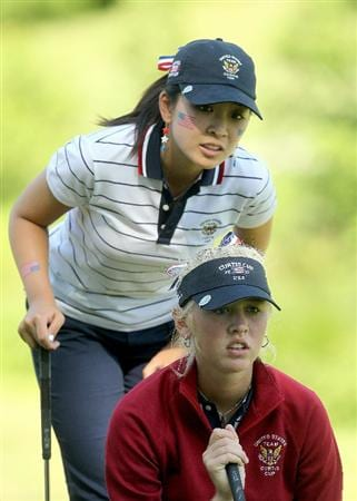 MANCHESTER, MA - JUNE 11: Jessica Korda and Tiffany Lua of the United States line up a putt during Four-Balls  competition of the 2010 Curtis Cup Match at the Essex Country Club on June 11, 2010 in Manchester, Massachusetts. (Photo by Jim Rogash/Getty Images)