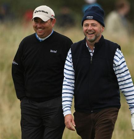 CARNOUSTIE, SCOTLAND - OCTOBER 02:  Gary Murphy of Ireland (L) and actor Aidan Quinn share a joke on the fourth hole during the second round of The Alfred Dunhill Links Championship at Carnoustie Golf Club on October 2, 2009 in Carnoustie, Scotland.  (Photo by Andrew Redington/Getty Images)