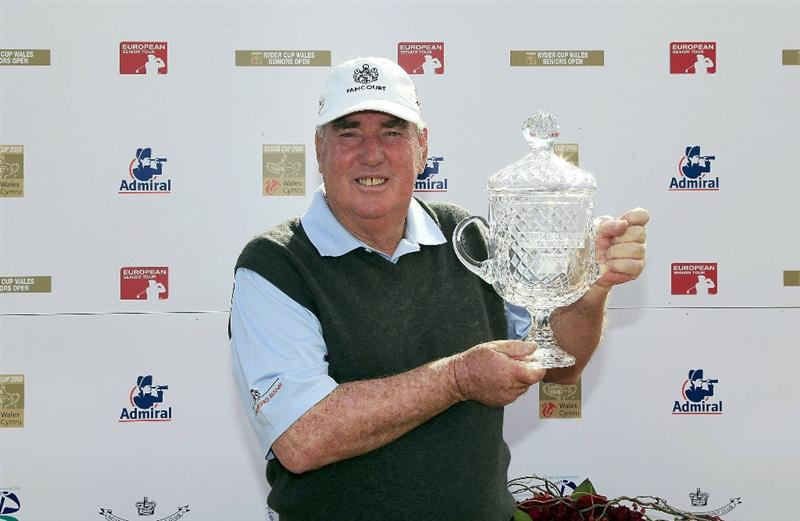 PORTHCAWL, WALES - JUNE 20:  John Bland of South Africa poses with the trophy after the final round of the Ryder Cup Wales Seniors Open played at Royal Porthcawl Golf Club on June 20, 2010 in Porthcawl, Wales.  (Photo by Phil Inglis/Getty Images)