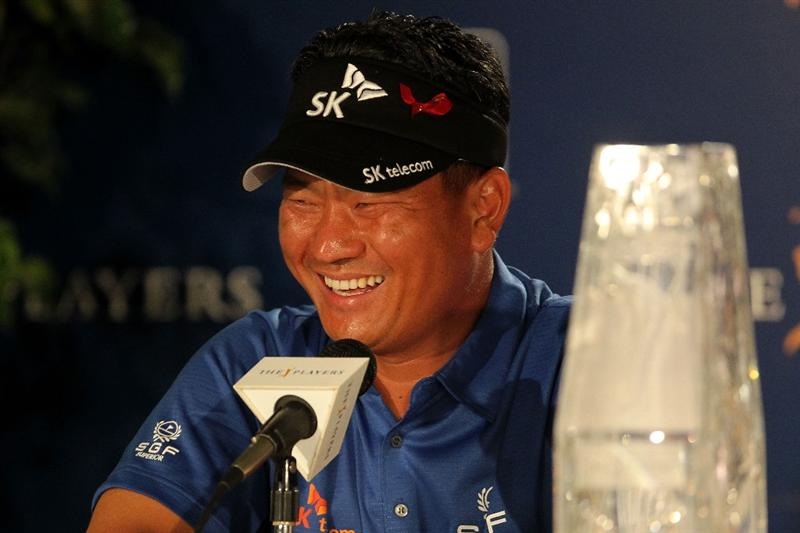 PONTE VEDRA BEACH, FL - MAY 15:  K.J. Choi of South Korea speaks with the media during a press conference after defeating David Toms on the first playoff hole to win THE PLAYERS Championship held at THE PLAYERS Stadium course at TPC Sawgrass on May 15, 2011 in Ponte Vedra Beach, Florida.  (Photo by Mike Ehrmann/Getty Images)