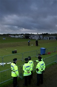 SOUTHPORT, UNITED KINGDOM - JULY 19:  Police watch over the practice ground as a player warms up during the third round of the 137th Open Championship on July 19, 2008 at Royal Birkdale Golf Club, Southport, England.  (Photo by David Cannon/Getty Images)