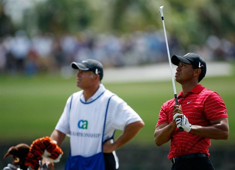 DORAL, FL - MARCH 15:  Tiger Woods hits his second shot on the 3rd hole during the final round of the World Golf Championships-CA Championship on March 15, 2009 at the Doral Golf Resort and Spa in Doral, Florida.  (Photo by Jamie Squire/Getty Images)