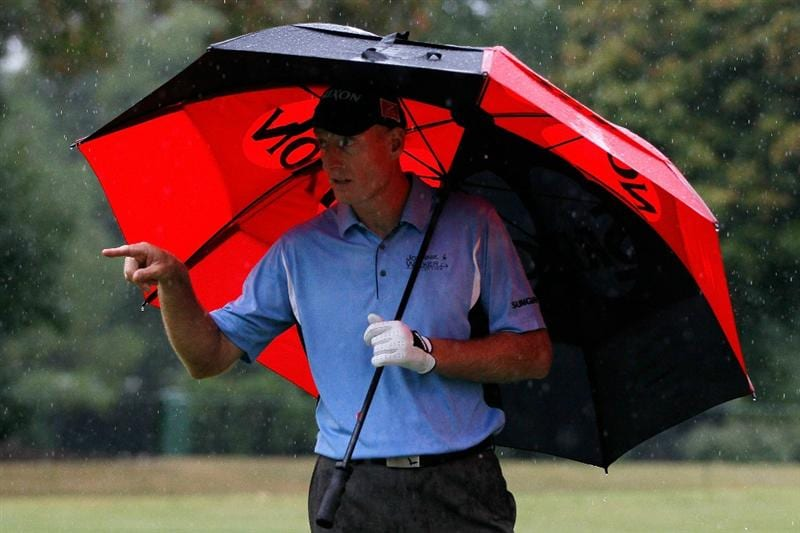 ATLANTA - SEPTEMBER 26:  Jim Furyk waits under an umbrella during the final round of THE TOUR Championship presented by Coca-Cola at East Lake Golf Club on September 26, 2010 in Atlanta, Georgia.  (Photo by Kevin C. Cox/Getty Images)